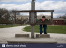 a-teenage-boy-pretends-to-be-locked-in-the-stockade-at-colonial-williamsburg-BB5AD6.jpg
